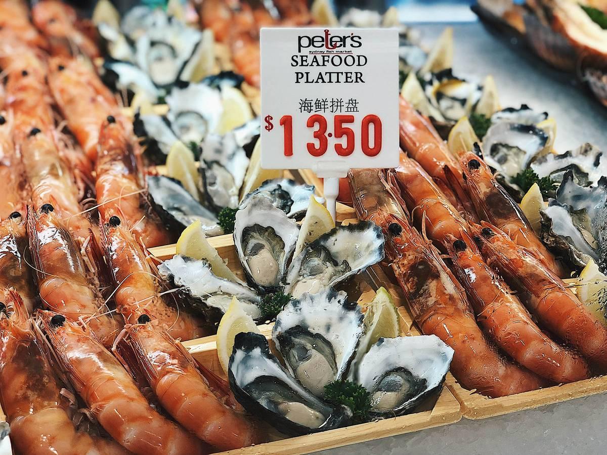 Тарелка морепродуктов на рынке стоит 13,5$