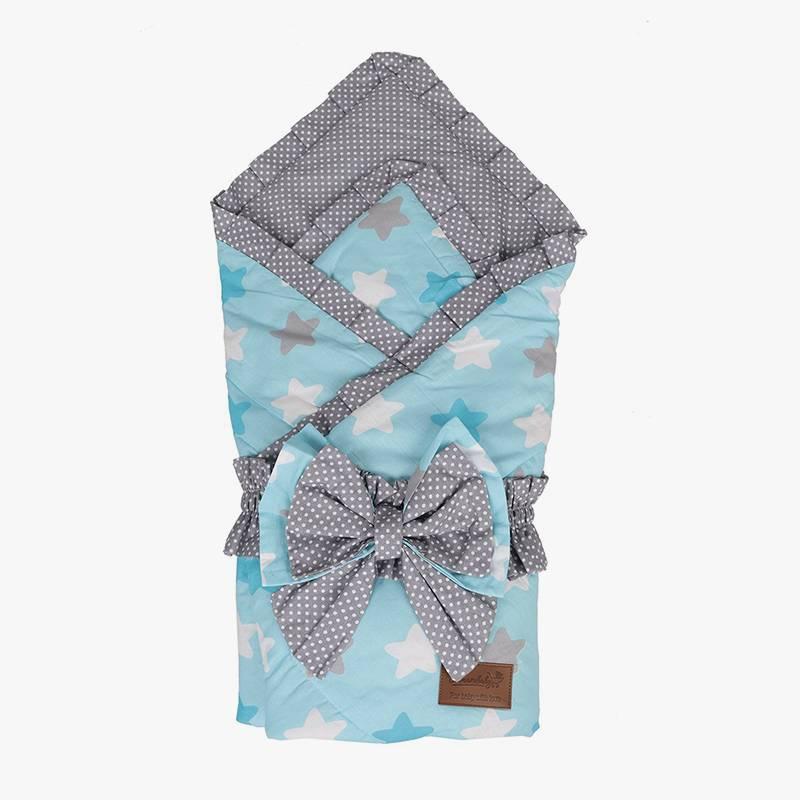 Такой конверт — это просто одеяло, которым оборачивают младенца. Сверху для красоты повязывают бант