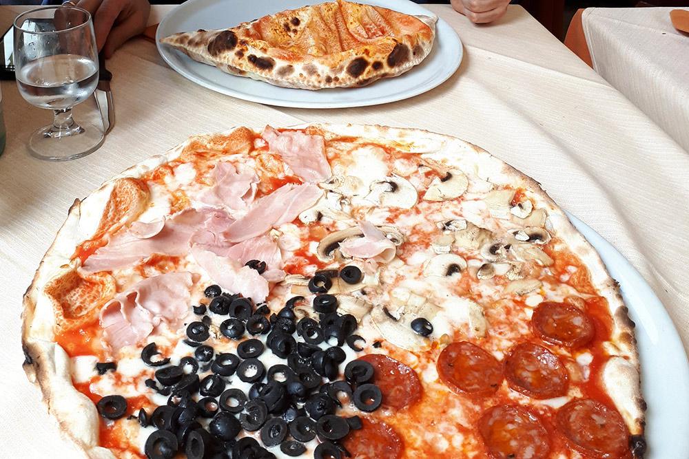 Кальцоне, пицца «Четыре вкуса» и вода стоили 22€ (1660<span class=ruble>Р</span>). Пицца была гораздо больше, чем та, к которой мы привыкли в России