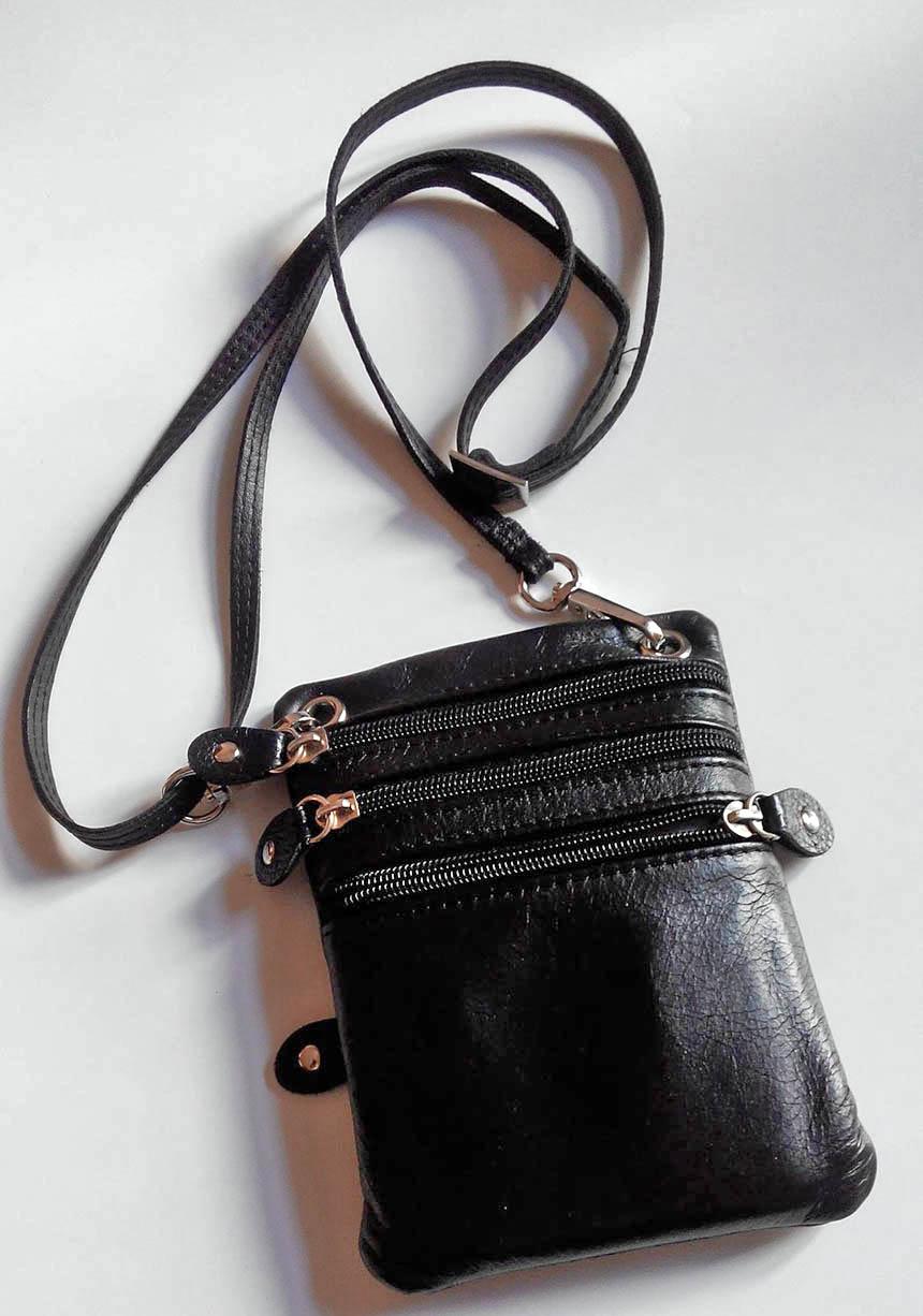 Сумка-антивор, которую Наталья носит на груди