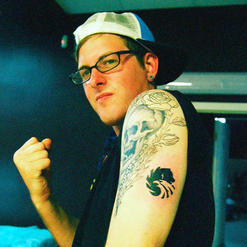 Один из участников группы Defiler набил татуировку с логотипом водки марки «Русский стандарт» в память о пребывании в России