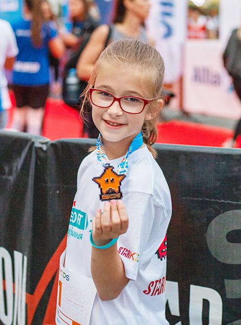 Тогда женаши дети впервые участвовали взабеге длиной 1км иполучили настоящие медали